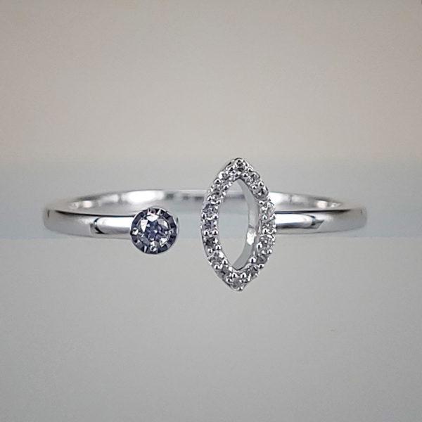 1/10th Carat Bezel Set Round Diamond Opposite Encrusted Oval Shaped Open Shank Ring